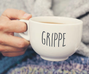 ill man and mug with word grippe, flu in french
