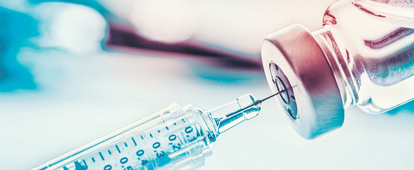 Close-up medical syringe with a vaccine.